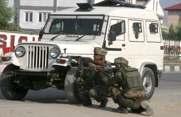 Army personnel taking positions after a militant strike outside Srinagar