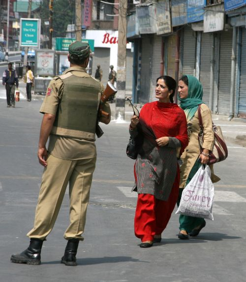 J&K Police personnel question women as during stringent restrictions in Srinagar on Tuesday