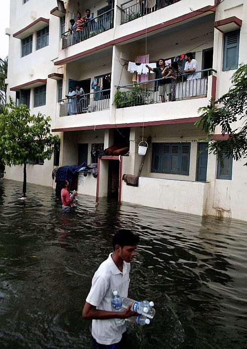 Volunteers supplying water bottles to residents stuck in a water logged society in Mumbai during the infamous July 26, 2005, floods
