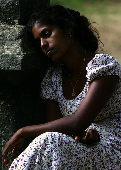 A homeless woman rests at a regugee camp in Chennai