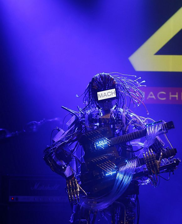 A member of the robot rock band Z-Machines, guitarist Mach, performs during the band's debut live concert in Tokyo