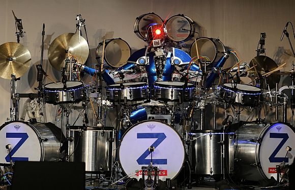 Robot rock band Z-Machines' drummer Ashura performs during the band's debut live concert