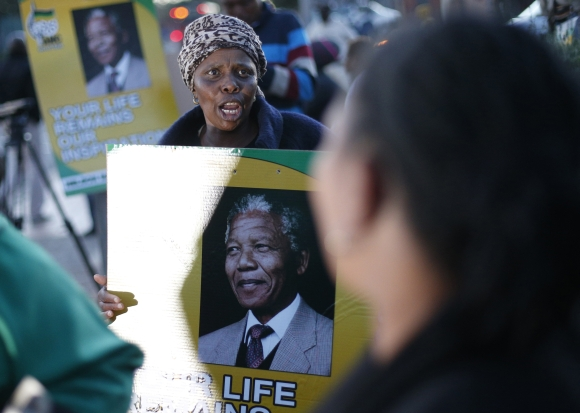 Wellwishers gather in support of ailing Mandela outside his former home in Soweto