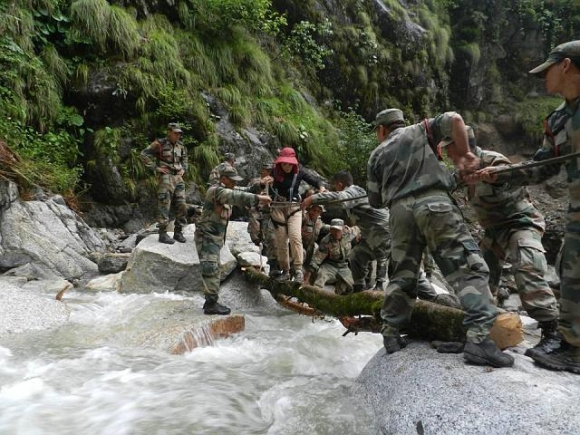 Army men rescue a tourist stranded in Uttarakhand