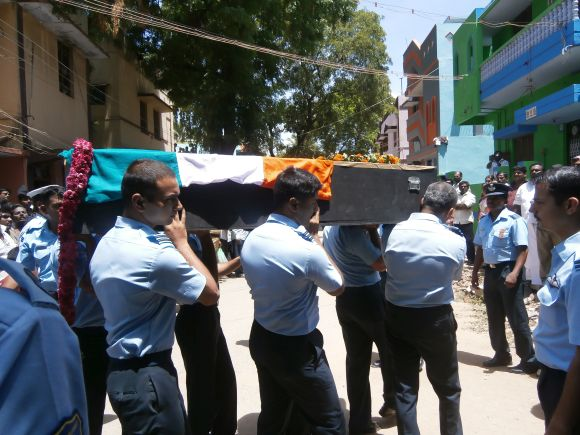 IAF personnel with the casket bearing K Praveen's body