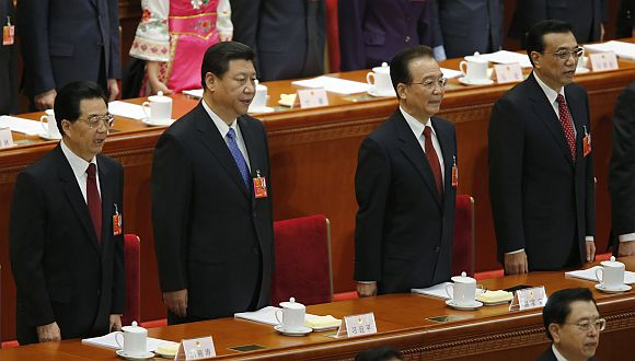 (From left to right) China's President Hu Jintao, China's Communist Party Chief Xi Jinping, China's Premier Wen Jiabao and Vice-Premier Li Keqiang sing the national anthem during the opening ceremony of National People's Congress