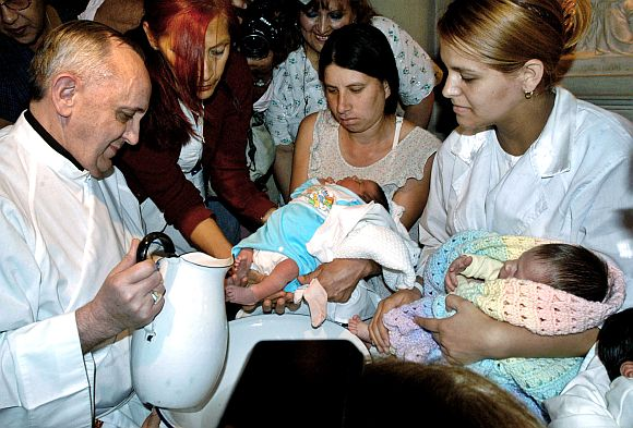 File photo of Argentine Cardinal Bergoglio washing the feet of two newly born children on Holy Thursday at the Buenos Aires' Sarda maternity hospital on March 24, 2005