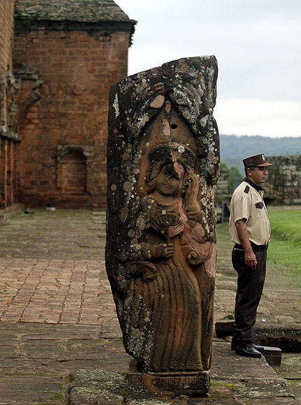 A security guard stands at the ruins of the Jesuit mission at Santisima Trinidad del Parana, Paraguay. The mission was built in 1706.