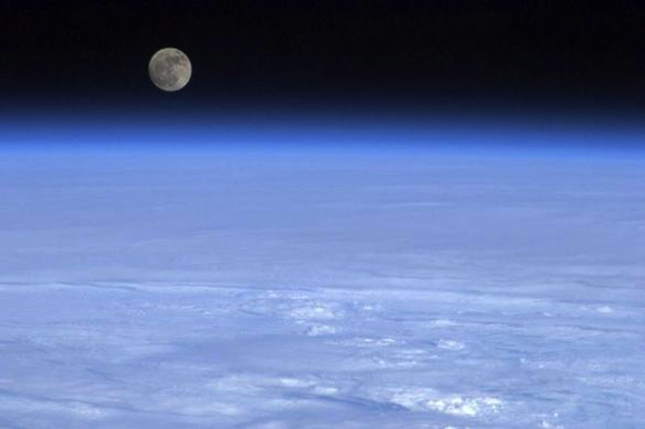 The moon is pictured above Earth