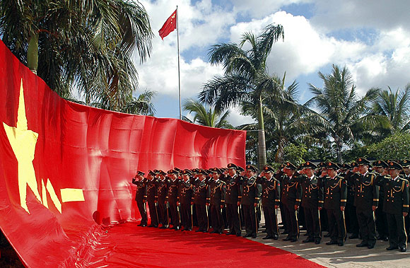 Frontier guards, dressed in the latest upgrade uniform, take an oath in front of the Chinese army flag in Wenchang, south China's Hainan province