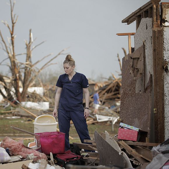 Dana Ulepich looks at the debris from her house destroyed by a powerful tornado ripped through the area in Moore, Oklahoma