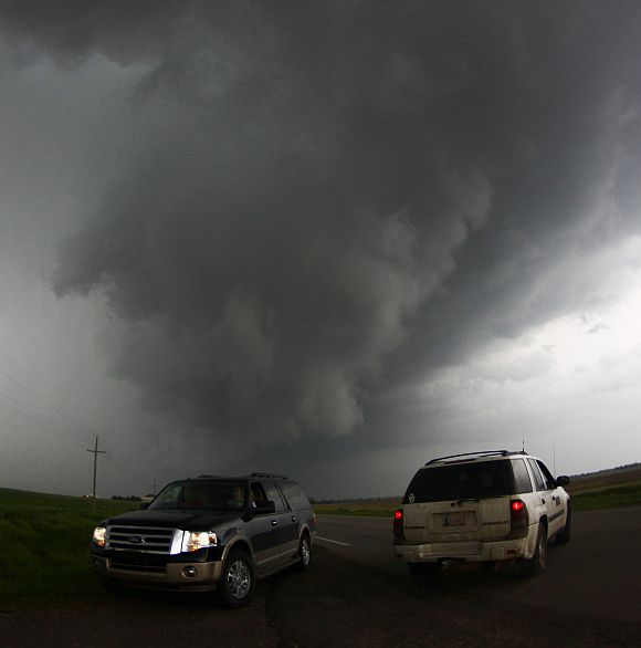 Storm chasers get close to a tornadic thunderstorm, one of several tornadoes that touched down