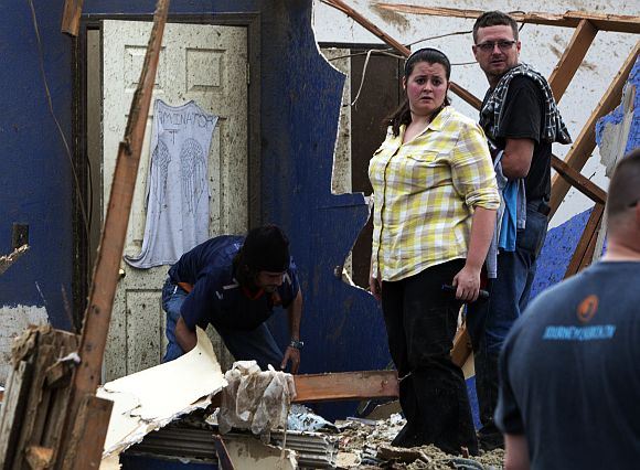 Local residents look through the debris