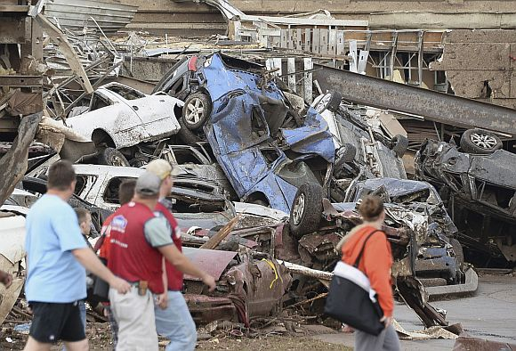 Damaged cars are seen in the parking lot of a Moore hospital