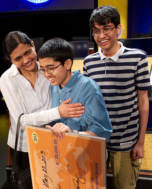 2013 National Geographic Bee winner Sathwik Karnik of Massachusetts is congratulated by his father, Vishwanath (not in picture), mother Rathna and brother Karthik. Karthik finished in the top 10 of the National Geographic Bee in 2011 and 2012