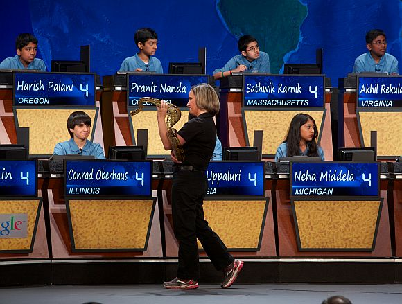 Amy Eveleth of the Baltimore Zoo displays boa constrictor Humphrey Bogart to the top 10 National Geographic Bee finalists during a round of the competition