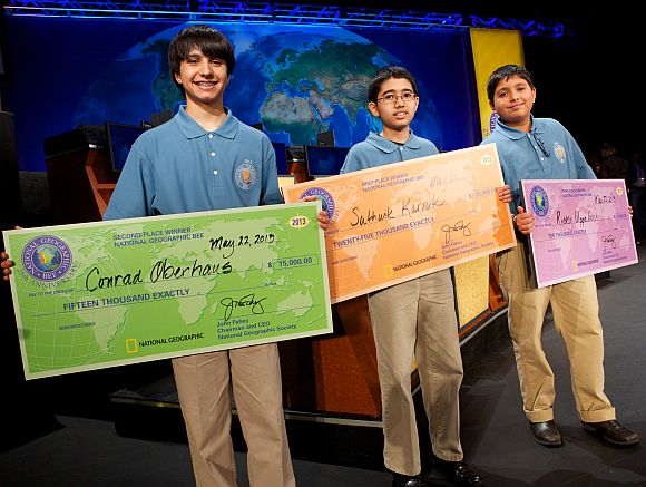 The top three winners of the 25th annual National Geographic Bee display their prizes
