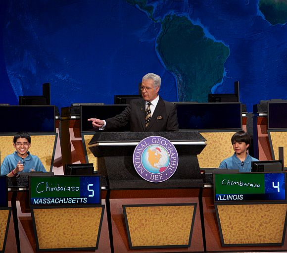 A thumbs-up from National Geographic Bee winner Sathwik Karnik, left, of Massachusetts as he correctly answers the final question posed by moderator Alex Trebek. The runner-up was Illinois' Conrad Oberhaus