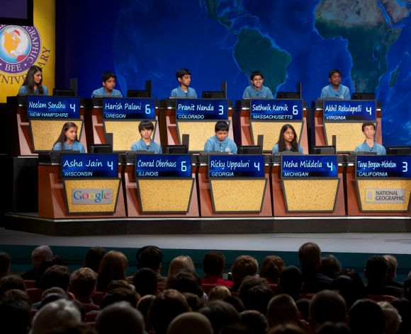 Bee moderator Alex Trebek quizzes the top10 finalists at the 25th National Geographic Bee held at The National Theatre in Washington