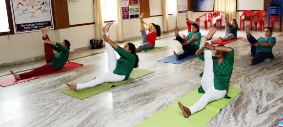 Students practising yoga asanas at the Indian School of Breathing in Chennai