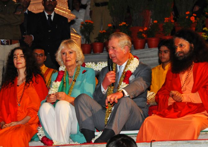 Prince Charles addresses a gathering on the banks of Ganga in Rishikesh on Wednesday