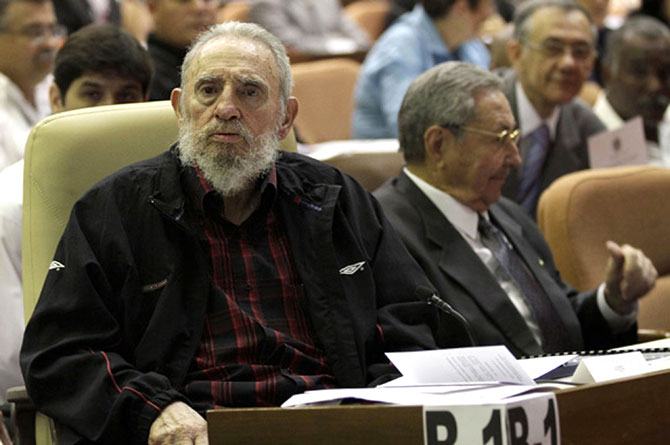 Fidel Castro, left, attends the opening session of the National Assembly of the People's Power beside his brother, Cuban President Raul Castro, in Havana, February 24, 2013. Castro made a rare public appearance as he took his long-empty seat beside his younger brother. He has graced the assembly chambers just once, in 2010, since taking ill in 2006 and ceding power to his brother.