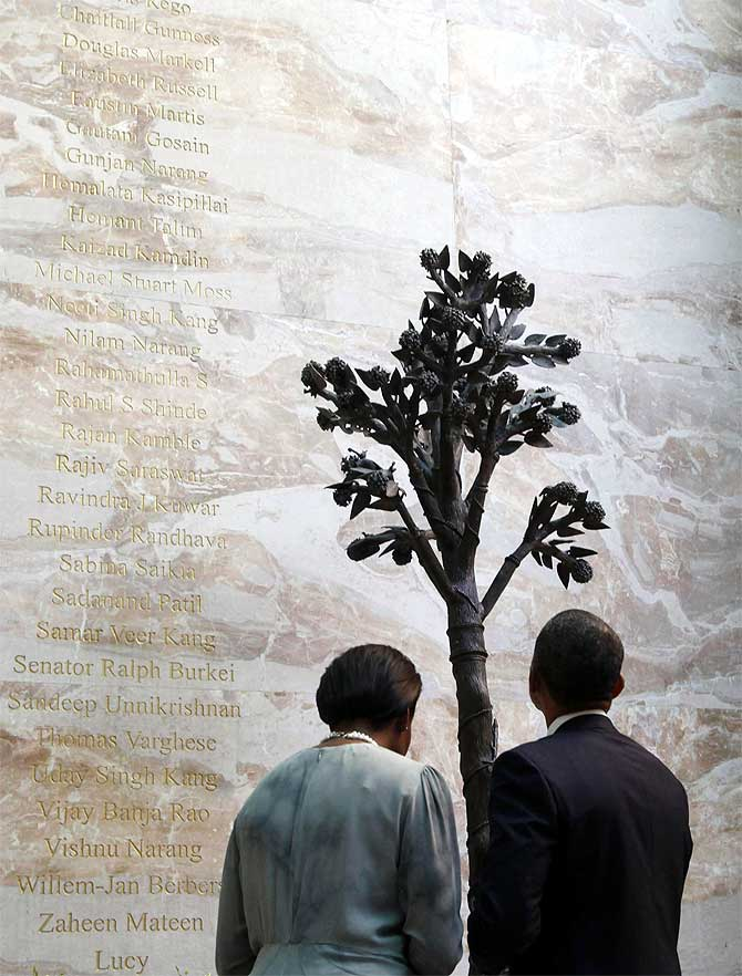 US President Barack Obama and First Lady Michelle Obama at the 26/11 memorial at the Taj Mahal Hotel in Mumbai, November 2010.