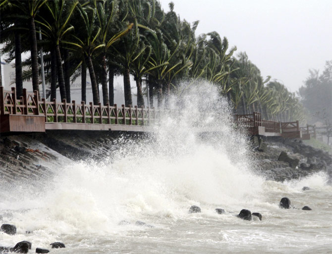 A wave surges under the influence of Typhoon Haiyan, in Haikou, south China's Hainan province
