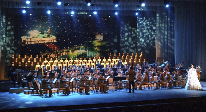 Members of the now disbanded Unhasu Orchestra perform the 2012 New Year's concert, 'The Cause of the Sun Will Be Immortal', at the East Pyongyang Grand Theatre in Pyongyang in this photograph taken on January 5, 2012.