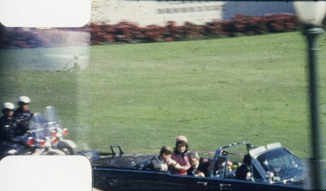 Frame 262 from Abraham Zapruder's 8mm film of JFK's assassination, Dallas, Texas, Nov. 22, 1963. President Kennedy's arms are raised, in a locked position, in front of him, after the first bullet has struck.