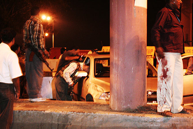 November 26, 2008, after midnight: After terrorist Ajmal Kasab's capture, a team of policemen check the Skoda Laura that he and his accomplice commandeered at Nariman Point and drove down Marine Drive.  Photograph: Uttam Ghosh/Rediff.com