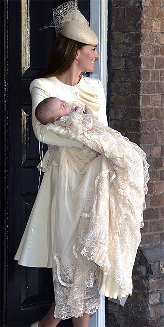 Britain's Catherine, Duchess of Cambridge carries her son Prince George after his christening at St James's Palace in London