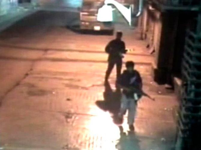 Closed circuit television footage shows Ajmal Kasab and Abu Ismail after their shooting spree at the Chhatrapati Shivaji Terminus, November 26, 2008.