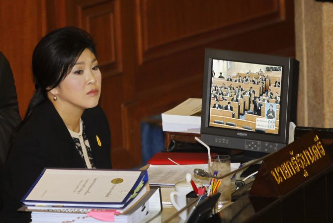 Thailand's Prime Minister Yingluck Shinawatra listens to a debate by the opposition in parliament in Bangkok