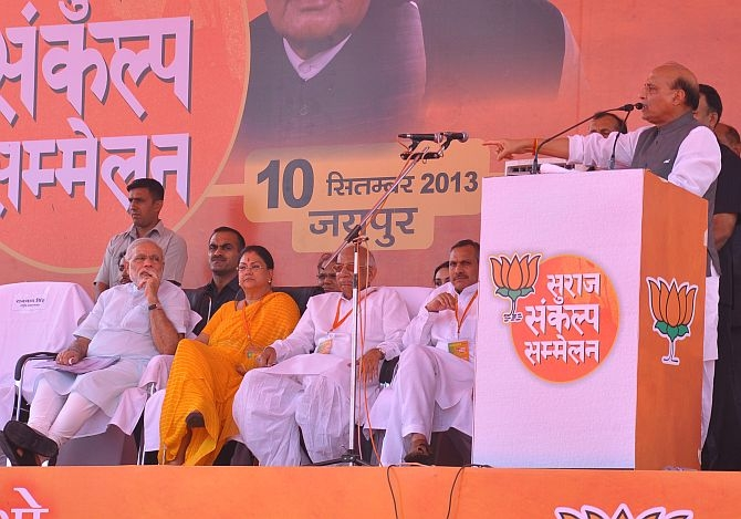 BJP President Rajnath Singh with the party's chief ministerial candidate Vasundhara Raje and PM candidate Narendra Modi at a poll rally in Jaipur