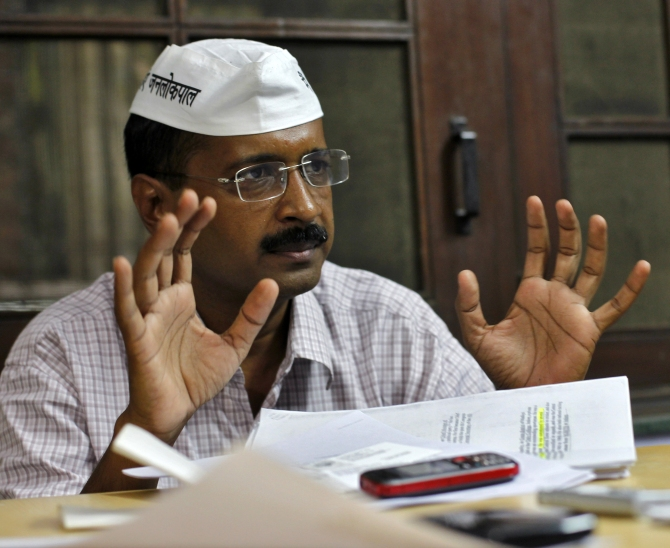 Arvind Kejriwal gestures as he speaks during an interview with Reuters in Ghaziabad on the outskirts of New Delhi