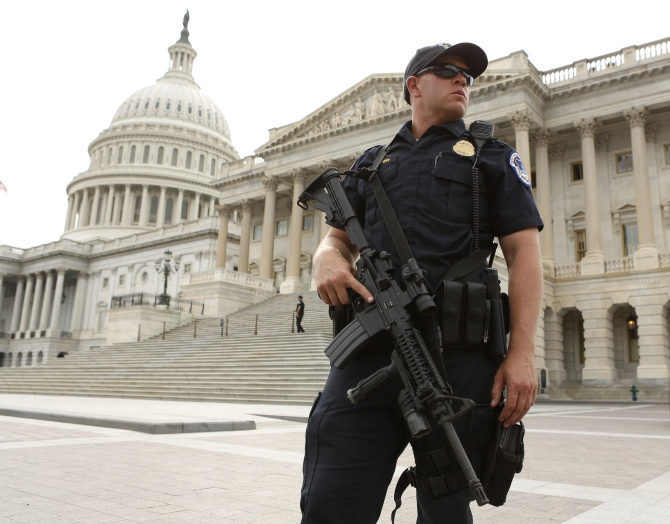 A police officer stands guard following a shooting near the US Capitol in Washington