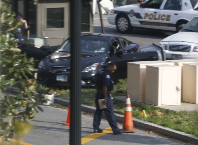 A black Infiniti coupe is pictured after its involvement in police shootout on Capitol Hill in Washington