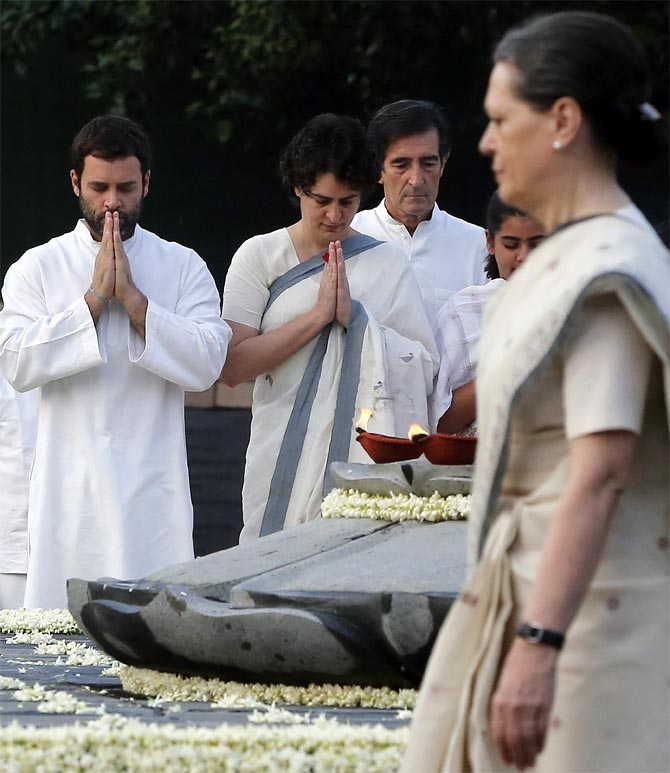 Rahul and Priyanka Gandhi with their mother Sonia Gandhi at their father Rajiv Gandhi's memorial in New Delhi.