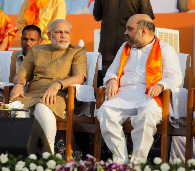 Amit Shah with Gujarat Chief Minister Narendra Modi at a function