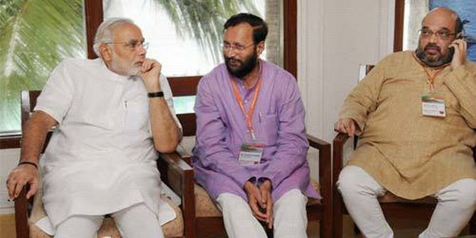Amit Shah with BJP's PM candidate Narendra Modi and party spokesperson Prakash Javdekar