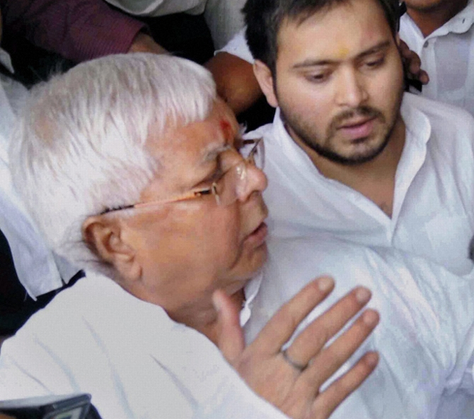 Lalu Prasad with his son Tejaswi outside a Ranchi court