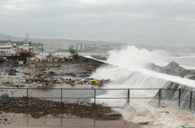 Waves crash onto the shore at a fishing harbour in Visakhapatnam district after cyclone Phailin hit India's east coast