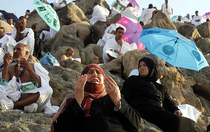 A Muslim pilgrim prays atop Mount Mercy on the plains of Arafat during the peak of the annual haj pilgrimage, near the holy city of Mecca