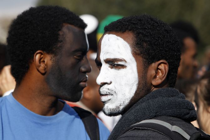 Protesters with their faces painted attend a demonstration in protest of the discrimination against Israelis of Ethiopian descent, in Jerusalem