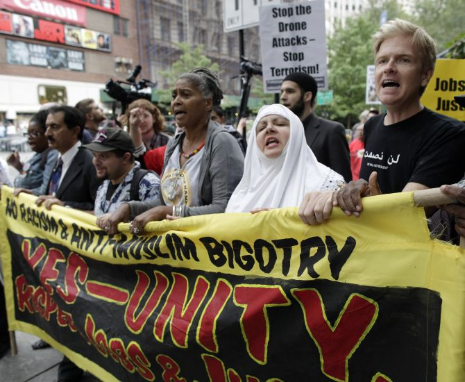 Protesters march in the 'Rally Against War, Racism & Islamophobia' to mark the 10th anniversary of the 9/11 attacks on the WorldTradeCenter, in New York