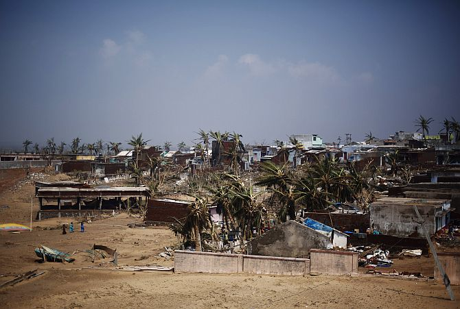 A view of damaged houses is pictured after Cyclone Phailin hit Arjyapalli village, in Ganjam district