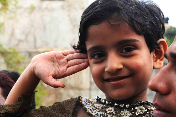 Firoz Khan's 4-year-old daughter Afshin Fatima seen saluting her father with a smiling face on Thursday