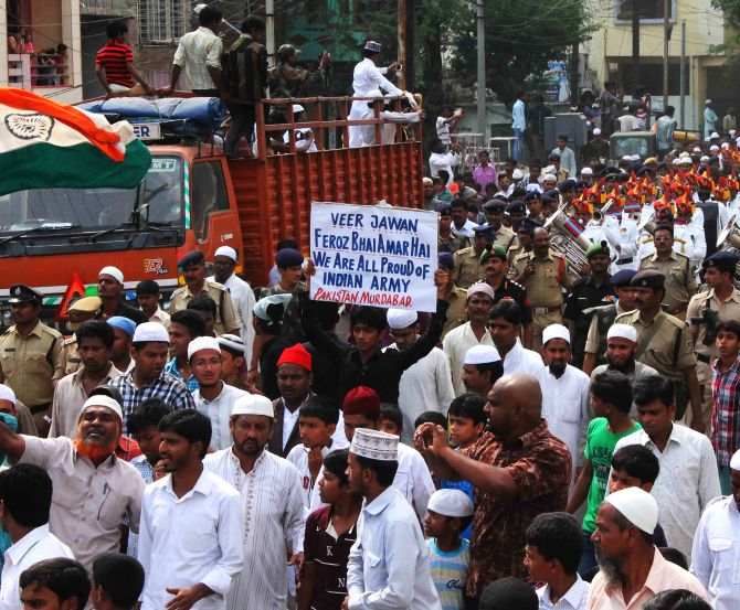 Mourners display anti-Pakistan banners at Lance Naik Firoz Khan's procession in Hyderabad