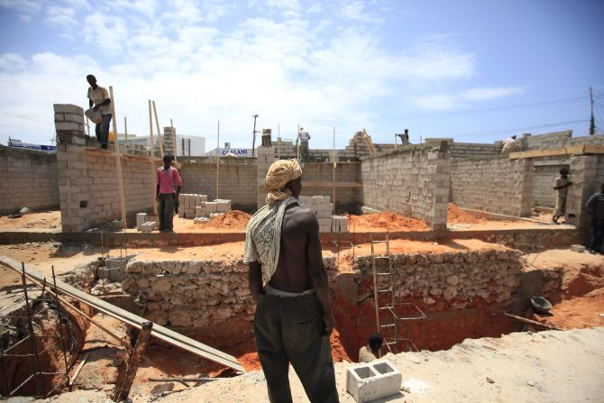 Labourers work at a petrol station construction site in Mogadishu
